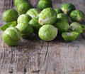 Brussels sprouts cabbage on old wooden table Stock Photo