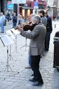 Brussels street quartet belgium july this is an image of four musicians playing classical music on a in belgium Royalty Free Stock Photo