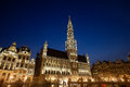 Brussels town hall grand place night scene with illuminated hotel de ville of bruxelles Stock Images