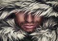 Brutal face of man with beard bristles and hooded winter a Royalty Free Stock Photo