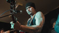 Brutal musician sing in microphone at rock-concert, telephoto