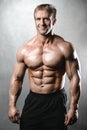 Brutal strong bodybuilder old man posing in studio grey backgrou Royalty Free Stock Photo