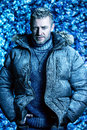 Brutal winter portrait of a handsome man dressed in clothes covered with frost Stock Image