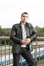 Brutal young man in a leather jacket Stock Photo