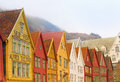 Bryggen bergen norway colorful old wooden buildings line the street in an area known as running along vagen harbor in the port Stock Photo