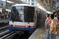 BTS Skytrain Arrives at Station in Bangkok Stock Photos