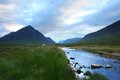 Buachaille etive mor at evening time scenery in scotland around with pastel colored cloudy sky summer Royalty Free Stock Photography