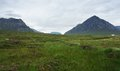 Buachaille etive mor at summer time clouded scenery in scotland around Stock Images
