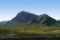 Buachaille etive mor in sunny ambiance mountain scenery scotland around clear blue sky Stock Photos