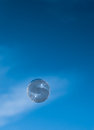 Bubble drifts across blue sky Stock Images