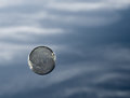 Bubble floating against cloudy sky Stock Photos