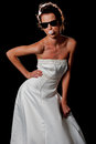 Bubble gum and Sunglasses in a bridal dress Royalty Free Stock Photos