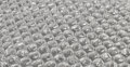 Bubble wrap background plastic often used in packaging fragile items for delivery in the post Stock Photos