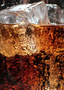 Bubbles in the glass of cola with ice. Royalty Free Stock Photo