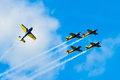BUCHAREST, ROMANIA, 2015: Acrobatic planes at Bucharest International Air Show (BIAS) with blue sky background Royalty Free Stock Photo