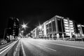 stock image of  Bucharest, Romania, June 28, 2015 - Business architecture at night - skyscrapers and street lights- in black and white