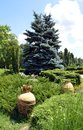 Bucharest romania two greek urns in herastrau park set amidst the gardens Royalty Free Stock Image