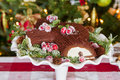 Buche de noel cake with christma decoration and cranberries Stock Photo