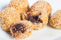 Buchi buchi sweet rice cake coated with sesame seeds and filled with sweet bean paste Royalty Free Stock Images