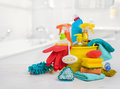 Bucket with chemical products on table over blurred bathroom background Royalty Free Stock Photo