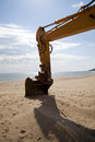 Bucket of an excavator on the beach Stock Image