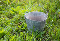 Bucket old metal on the grass Royalty Free Stock Photography