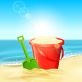 Bucket of sand and shovel on beach Royalty Free Stock Photo