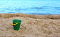Bucket on the sandy beach Stock Photography
