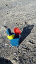 Beach Bucket and spades on sea sand Royalty Free Stock Photo