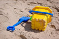 Bucket and Spade on Beach Royalty Free Stock Images