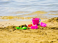 Bucket and spade on the beach Stock Photos