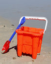 Bucket and spade a on the beach Stock Image