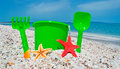 Bucket and spade by the shore in sardinia Royalty Free Stock Images