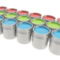 Buckets full of paint over white background Stock Images