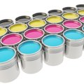 Buckets full of paint over white background cmyk colored oil Stock Image