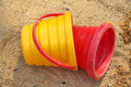 Buckets in the sandbox red and yellow bucket Royalty Free Stock Photography