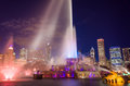 Buckingham fountain chicago in grant park at night lit by colorful lights Stock Images