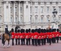 Buckingham palace changing of the guard ceremony at with soldiers wearing traditional red coats and fur hats Royalty Free Stock Photo