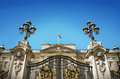 Buckingham palace gate and british flag panoramic view of door flying on blue sky Stock Photo