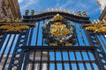 Buckingham palace s gate with great and beautiful sign affix Royalty Free Stock Image