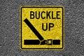 Buckle up on the asphalt sign Stock Photos