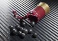 Buckshot load shotshell that has been opened and showing its big lead shot Stock Images