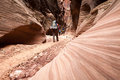 Buckskin gulch canyon hikers weave through the deep walls of in southern utah Royalty Free Stock Photo
