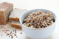 Buckwheat with bread and rye on plate on a wooden background Stock Image