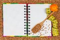 Buckwheat diet notebook for the recipe of a with tape measure closeup Royalty Free Stock Photos