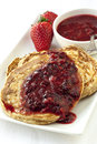 Buckwheat Pancakes with Berry Coulis Royalty Free Stock Photo