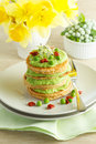 Buckwheat pancakes with peas cream and sprouts Stock Photo