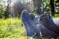 Bucolic blue boots crossed over green grass spring background Royalty Free Stock Image