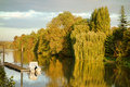 Bucolic and peaceful seine river in ile de france scenic view of the low with beautiful trees on the riverbank a small pleasure Royalty Free Stock Photo