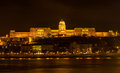 Buda castle royal palace by the danube river illuminated at night in budapest hungary Stock Images